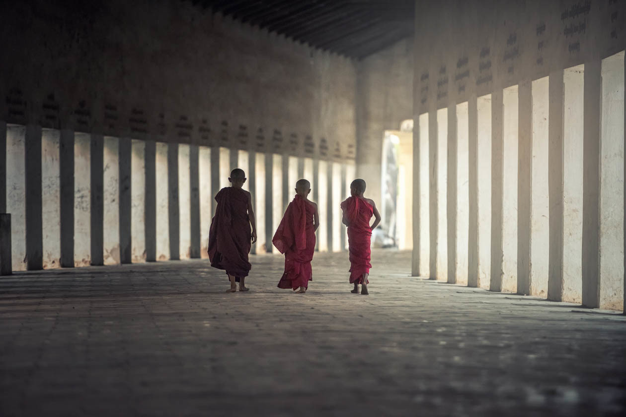 Young boys walk through a walkway