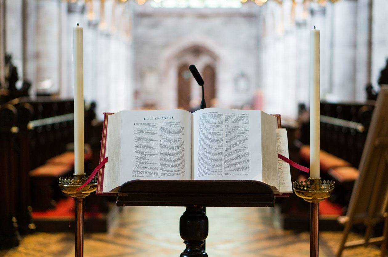 A Bible at the front of the church lies open to Ecclesiastes in Hereford, UK